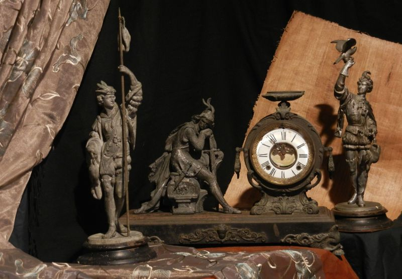 "Mama Sitges' ""Ivanhoe"" mantle clock, with side pieces ""Fisher"" and ""Falconer"""